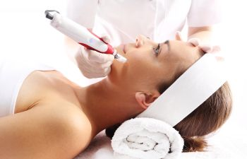 Woman Receiving Microneedling Treatment Atlanta GA